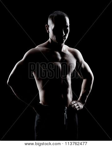 Silhouette of a strong man