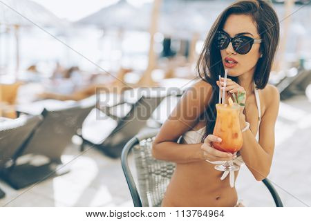Beautiful Girl Drinking Cocktail On Beach