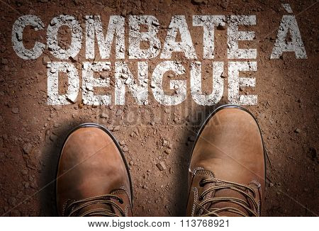 Top View of Boot on the trail with the text: Defend Against Dengue (in Portuguese)