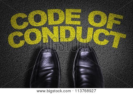Top View of Business Shoes on the floor with the text: Code of Conduct