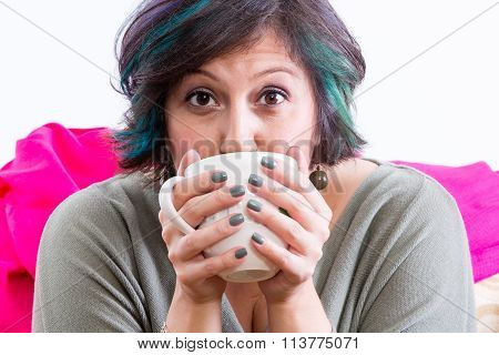 Excited Woman Holding Coffee Mug