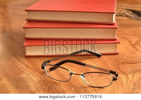 Book with a red cover three books