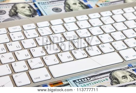 Computer Keyboard Lying On A  On The Background Of Dollars