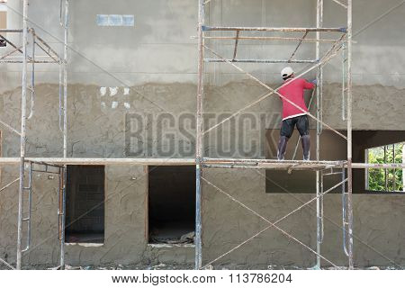 Plasterer Cement Concrete Man Worker Stand On Scaffold Steel Plastering Wall Of Residential Construc