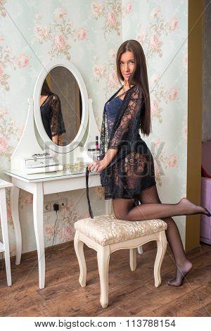 Seductive girl in underwear near boudoir