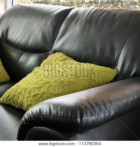 Black Leather Sofa Furniture With Green Pillow In Livingroom