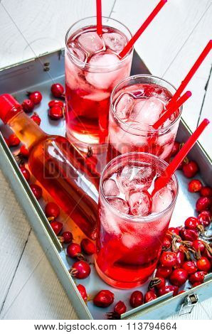 Three Berry Cocktail With Liquor And Ice On A Tray .