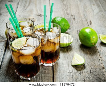 Fresh Cocktail With Lime And Mint On Wooden Table.