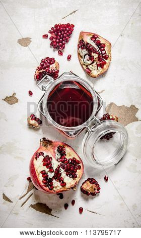 Pomegranate Juice In A Jar With Pieces Of Ripe Pomegranate.