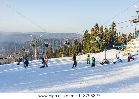 Skiers And Snowboarders On The Slopes.