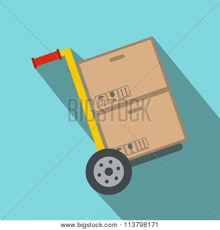 Yellow hand cart with cardboard boxes