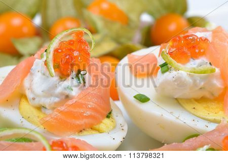 Eggs with salmon and caviar