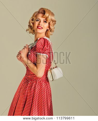 charming blonde pin-up girl with little bag