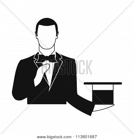 Magician in a black suit holding an empty top hat