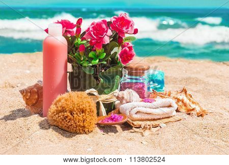 Spa Beauty Products: Towels, Soap, Shells, Sea Salt And Pink Flowers Roses In The Flowerpot On The S