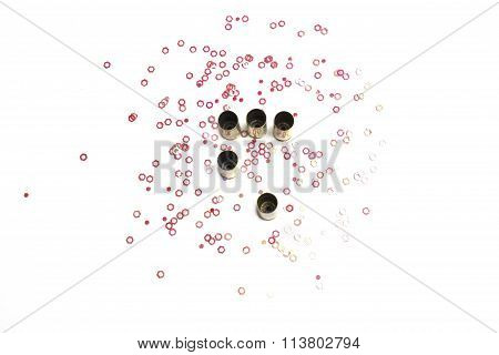 Empty 9mm bullet shells over white background with red hexagon small objects