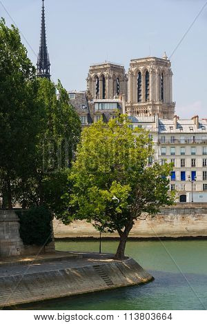 Notre Dame De Paris Cathedral Towers, Seine River In Summer