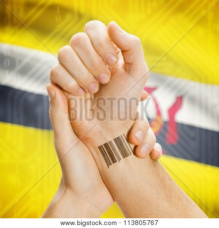 Barcode Id Number On Wrist And National Flag On Background - Brunei