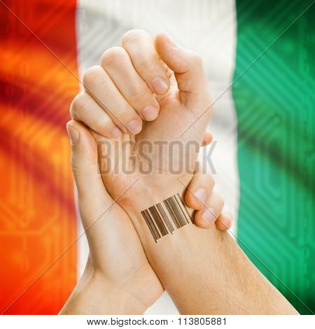 Barcode Id Number On Wrist And National Flag On Background - Ivory Coast