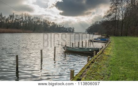 Row Of Moored Rowing Boats In Backlit