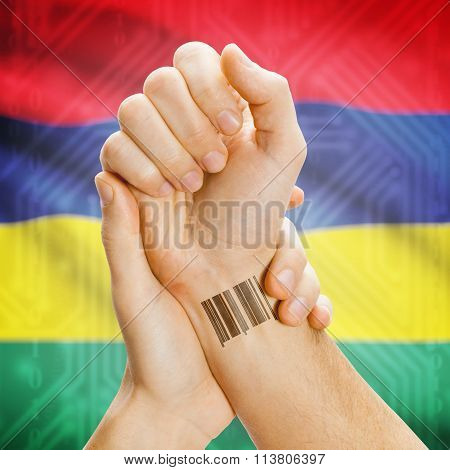Barcode Id Number On Wrist And National Flag On Background - Mauritius