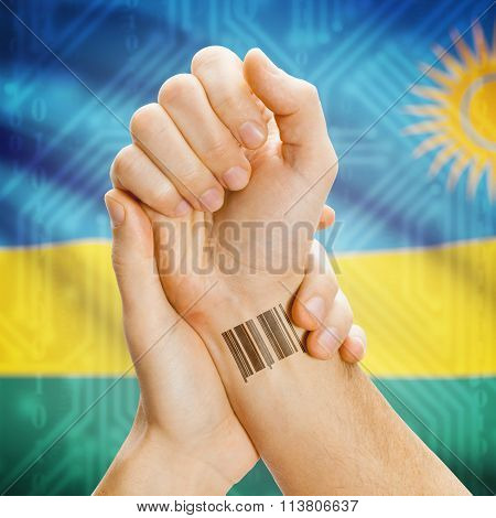 Barcode Id Number On Wrist And National Flag On Background - Rwanda