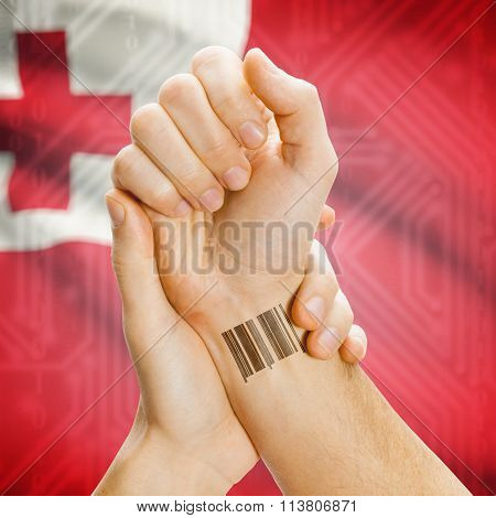 Barcode Id Number On Wrist And National Flag On Background - Tonga