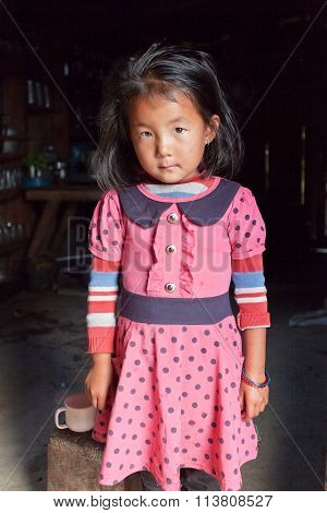 Nepalese Little Girl In Typical Nepalese Kitchen