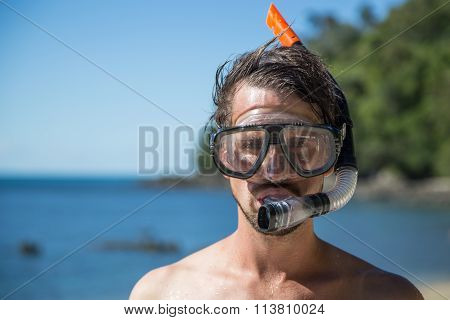 Young man with snorkeling gear