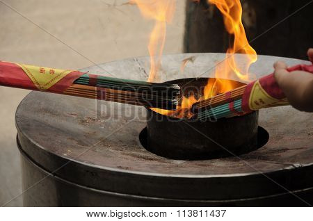Burning Incense at a temple