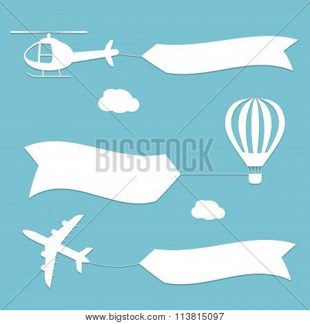 Plane, air balloon and helicopter flying with advertising banners.