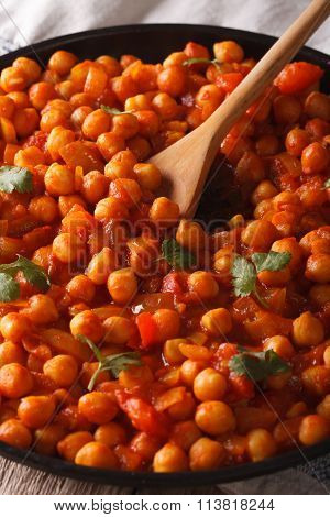 Traditional Indian Cuisine: Chana Masala Macro. Vertical