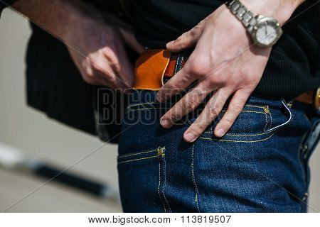 man dressed in jeans, a close-up shot