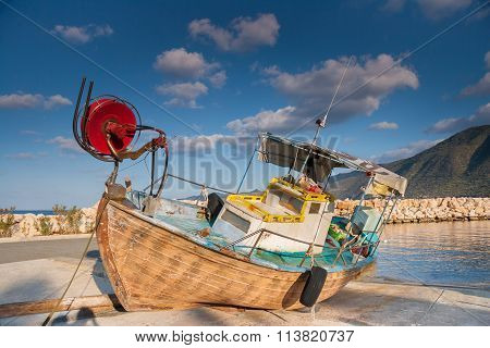 Wooden Fishing Boat Out Of Sea In Afternoon Light In  Pomos Harbor, Cyprus