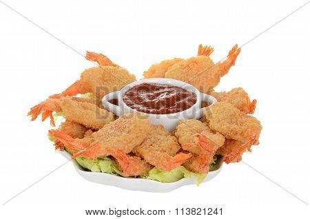 isolated butterfly shrimp with seafood sauce