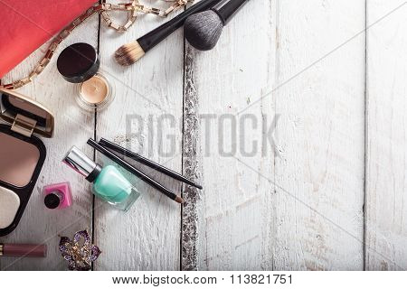 Female Handbag With Cosmetics And Mobile On White Wood