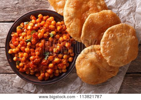 Delicious Indian Chana Masala And Puri Close-up. Horizontal Top View