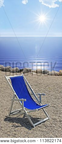 Sunbed At The Stony Beach, Blue Wavy Water And Bright Sunshine