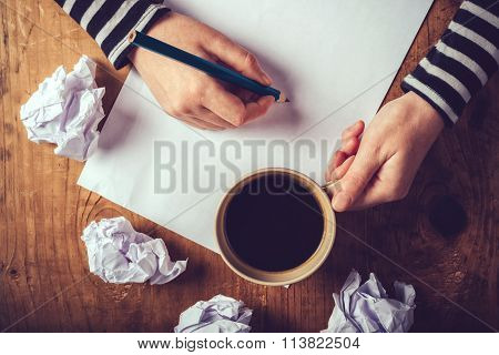 Female Writer Drinking Cup Of Coffee