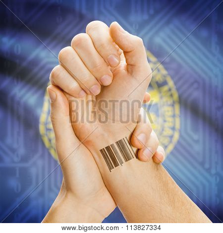 Barcode Id Number On Wrist And Usa States Flags On Background - Nebraska