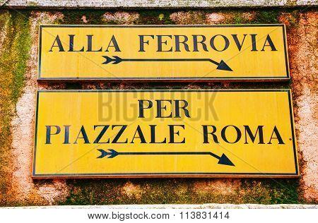 Alla Ferrovia And Piazzale Roma Direction Sign In Venice