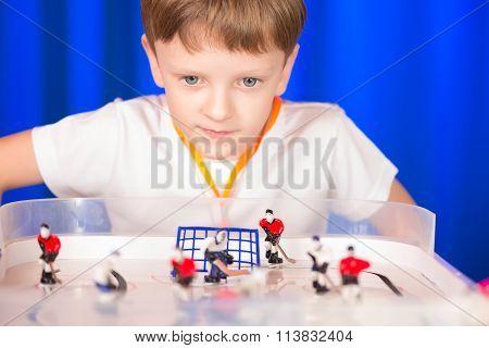 Boy Playing Table Hockey