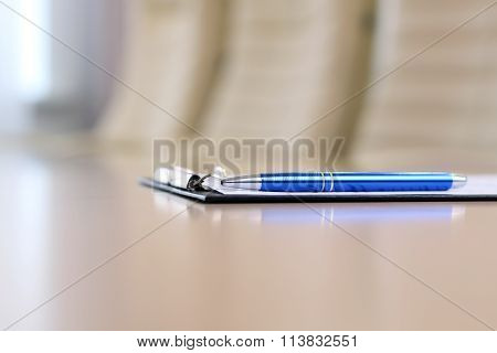 Closeup Pen On Table In Empty Corporate Conference Room Before Business Meeting