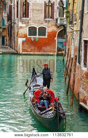 Gondola With Tourists In Venice, Italy