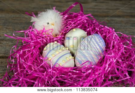 Easter egg cookies in pink nest