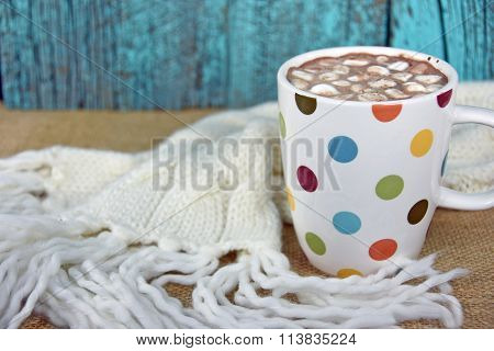 hot chocolate drink with knit scarf