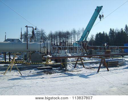 Russia, Yuzhno-Sakhalinsk - November 18, 2014: Platform of construction of pipelines. Booster pump station.