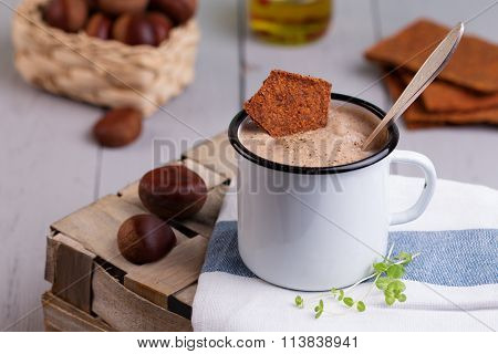 Chestnut Soup In White Enamel Mug With Roasted Chestnuts
