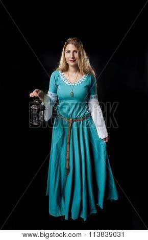 Medieval Girl In Turquoise Dress With A Vintage Lamp