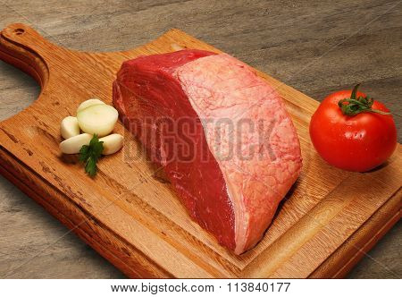 Raw Meat Selection On Wooden Cutting Board.